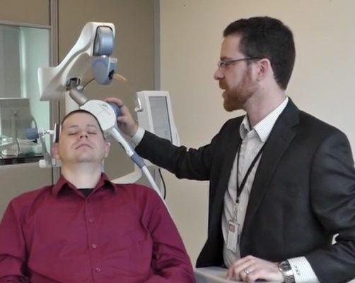 Researcher assisting a participant.