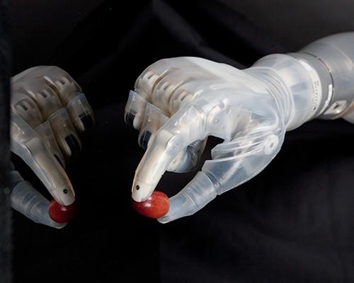 Robotic hand grasping a small ball.