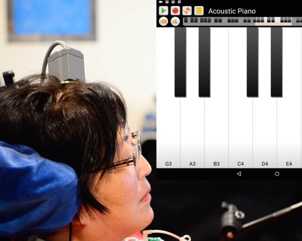 A test subject uses the BrainGate BCI to play Ode to Joy on a virtual keyboard interface.