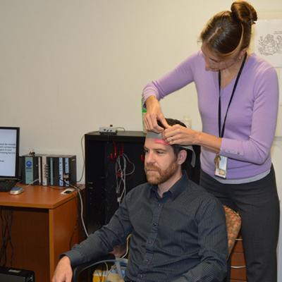 Researcher places cap on participant.